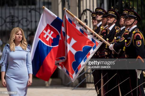 Slovakia's new President Zuzana Caputova reviews the guard of honour at the Presidential Palace during her inauguration ceremony in Bratislava...