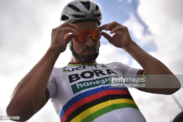 Slovakia's Peter Sagan adjusts his sunglasses as he prepares to depart for a training session of Germany's BoraHansgrohe cycling team on July 6 2018...