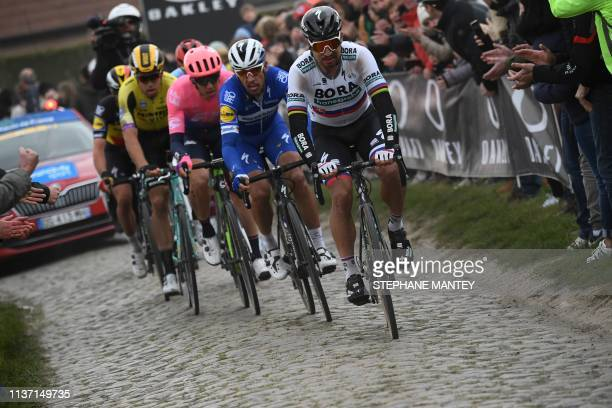 Slovakia's Peter Sagan and Belgium's Philippe Gilbert lead as they ride on the Roubaix cobbled stones sector during the 117th edition of the...