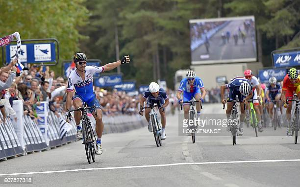 Slovakia's Peter Sagan celebrates as he crosses the finish line ahead of France's Julian Alaphilippe and Spain's Daniel Moreno Fernandez to win the...