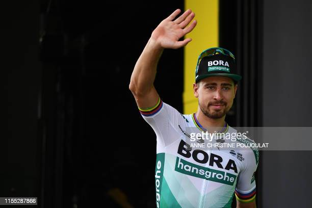 Slovakia's Peter Sagan celebrates his best sprinter's green jersey on the podium of the seventh stage of the 106th edition of the Tour de France...