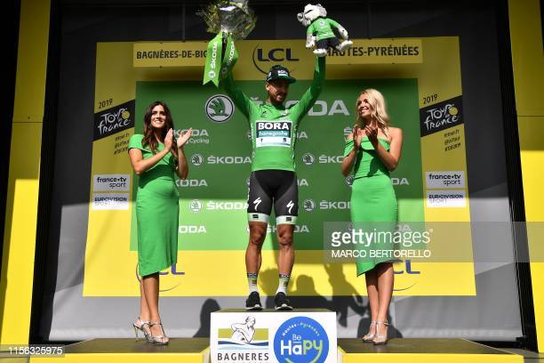 Slovakia's Peter Sagan celebrates his best sprinter's green jersey on the podium of the 106th edition of the Tour de France cycling race between...
