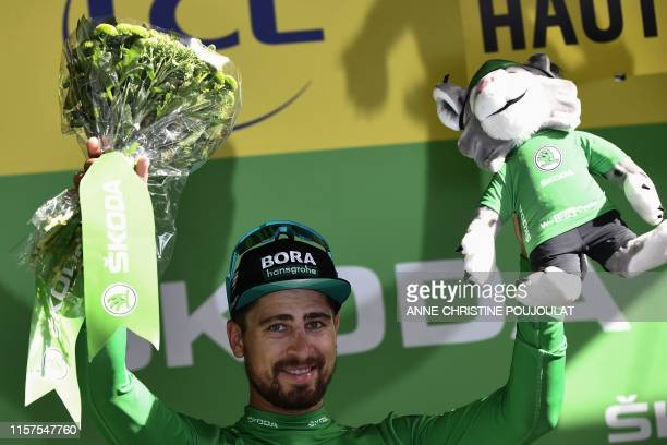 Slovakia's Peter Sagan celebrates his best sprinter's green jersey on the podium of the seventeenth stage of the 106th edition of the Tour de France...