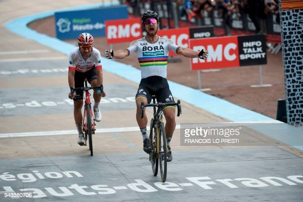 Slovakia's Peter Sagan celebrates winning ahead of Switzerland's Silvan Dillier during the 116th edition of the ParisRoubaix oneday classic cycling...