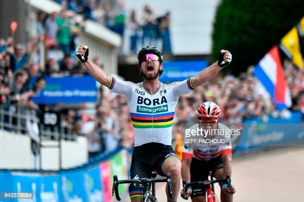 TOPSHOT Slovakia's Peter Sagan celebrates winning the 116th edition of the ParisRoubaix oneday classic cycling race between Compiegne and Roubaix on...