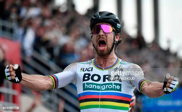 Slovakia's Peter Sagan celebrates winning the 116th edition of the Paris-Roubaix one-day classic cycling race, between Compiegne and Roubaix, on...