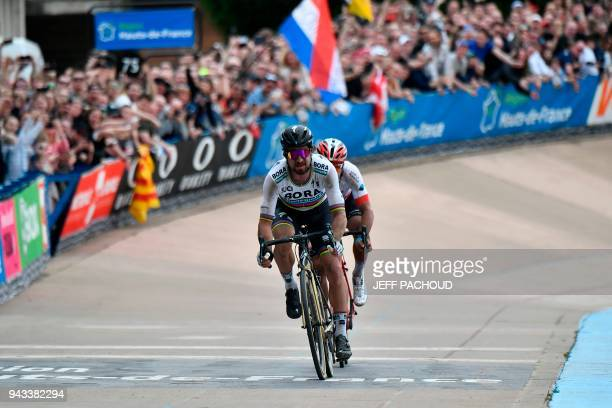 Slovakia's Peter Sagan competes to win ahead of Switzerland's Silvan Dillier during the 116th edition of the ParisRoubaix oneday classic cycling race...