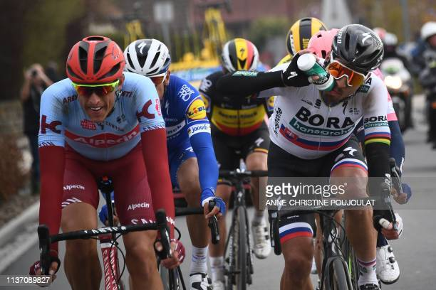 Slovakia's Peter Sagan drinks past Germany's Nils Politt as they lead during the 117th edition of the Paris-Roubaix one-day classic cycling race,...