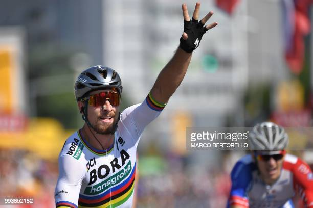Slovakia's Peter Sagan gestures as he celebrates after crossing the finish line to win the second stage of the 105th edition of the Tour de France...