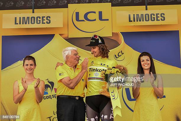 Slovakia's Peter Sagan is congratulated by French former cyclist Raymond Poulidor as he celebrates his overall leader yellow jersey on the podium at...