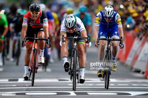 TOPSHOT Slovakia's Peter Sagan sprints to win ahead of Belgium's Greg Van Avermaet and Ireland's Daniel Martin at the end of the 2125 km third stage...
