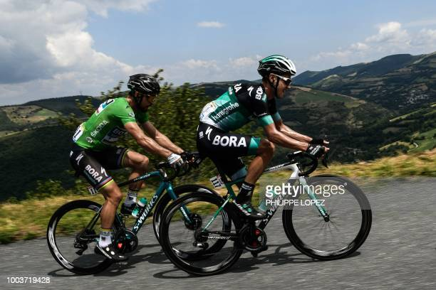 Slovakia's Peter Sagan wearing the best sprinter's green jersey and Poland's Pawel Poljanski ride during the 15th stage of the 105th edition of the...
