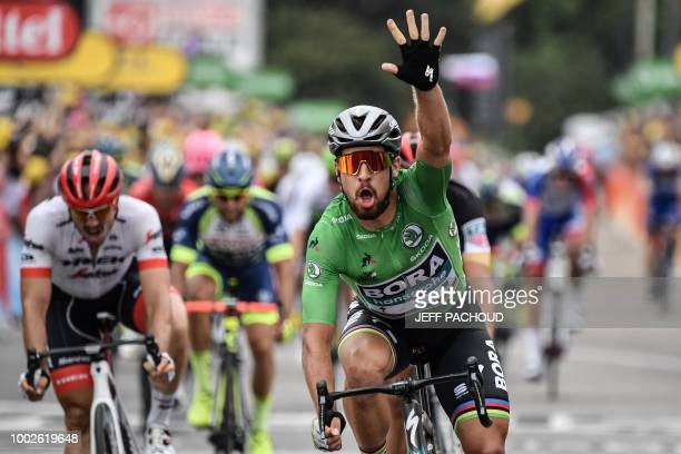 Slovakia's Peter Sagan, wearing the best sprinter's green jersey, celebrates as he crosses the finish line to win the 13th stage of the 105th edition...
