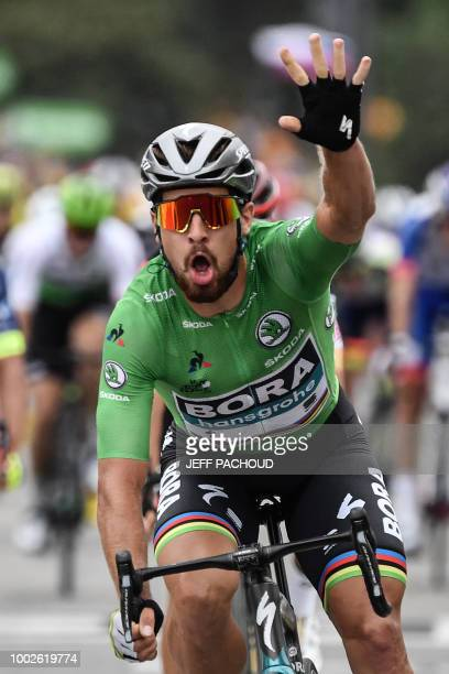 Slovakia's Peter Sagan wearing the best sprinter's green jersey celebrates as he crosses the finish line to win the 13th stage of the 105th edition...