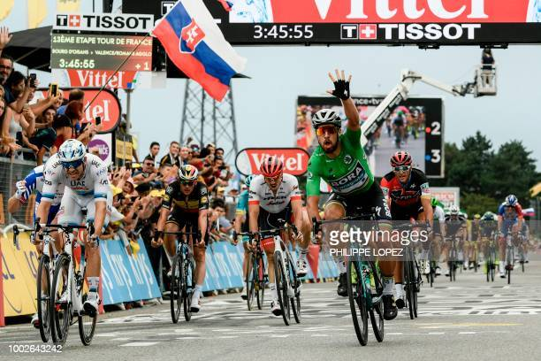 TOPSHOT Slovakia's Peter Sagan wearing the best sprinter's green jersey celebrates as he crosses the finish line to win ahead of Norway's Alexander...
