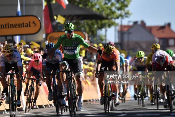 Slovakia's Peter Sagan , wearing the best sprinter's green jersey celebrates as he wins on the finish line of the fifth stage of the 106th edition of...