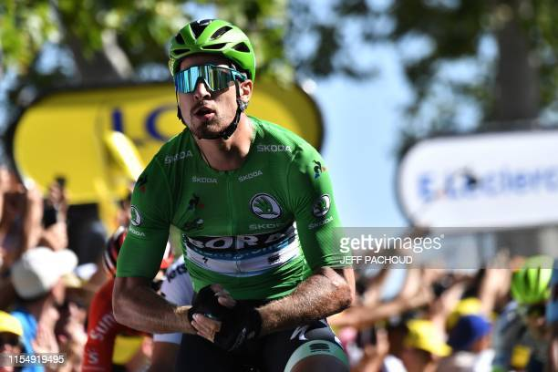 Slovakia's Peter Sagan, wearing the best sprinter's green jersey celebrates as he wins on the finish line of the fifth stage of the 106th edition of...