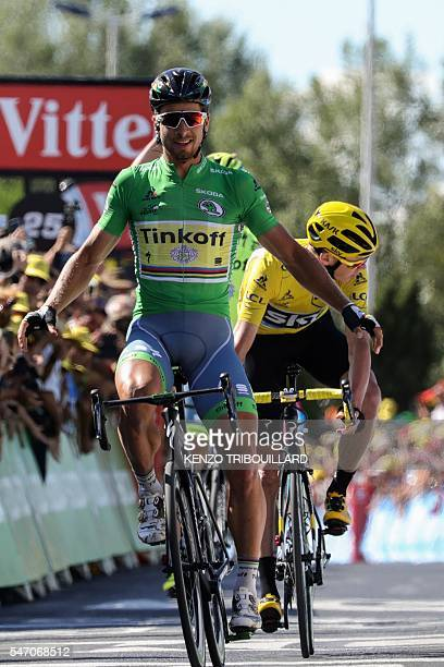 Slovakia's Peter Sagan wearing the best sprinter's green jersey celebrates as he crosses the finish line ahead of Great Britain's Christopher Froome...