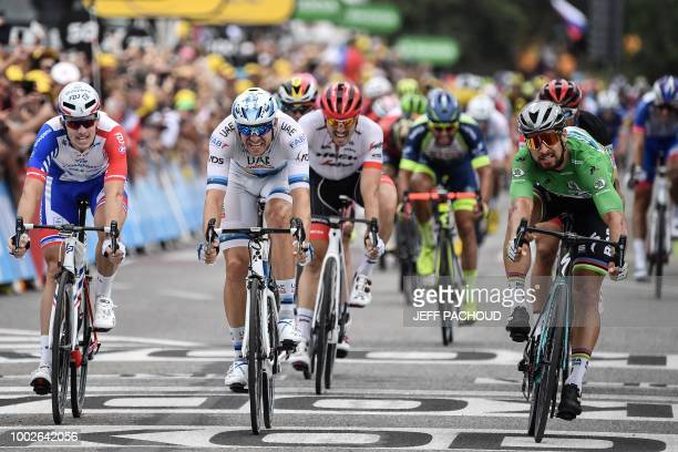 Slovakia's Peter Sagan wearing the best sprinter's green jersey crosses the finish line and wins ahead of Norway's Alexander Kristoff and France's...