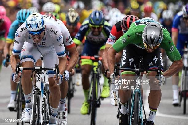 Slovakia's Peter Sagan wearing the best sprinter's green jersey crosses the finish line and wins ahead of Norway's Alexander Kristoff the 13th stage...