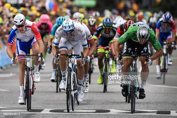 TOPSHOT Slovakia's Peter Sagan wearing the best sprinter's green jersey crosses the finish line and wins ahead of Norway's Alexander Kristoff and...