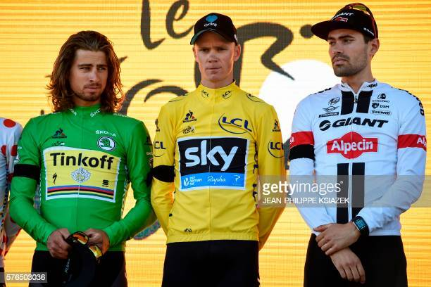 Slovakia's Peter Sagan wearing the best sprinter's green jersey Great Britain's Christopher Froome wearing the overall leader's yellow jersey and...