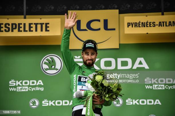 Slovakia's Peter Sagan wearing the best sprinter's green jersey celebrates on the podium after the 20th stage of the 105th edition of the Tour de...