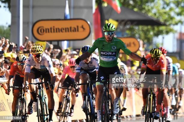 Slovakia's Peter Sagan wearing the best sprinter's green jersey celebrates past Belgium's Wout van Aert wearing the best young's white jersey as he...