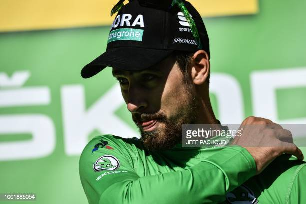 Slovakia's Peter Sagan wearing the best sprinter's green jersey reacts on the podium after the twelfth stage of the 105th edition of the Tour de...