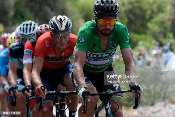 Slovakia's Peter Sagan , wearing the best sprinter's green jersey, rides in a 32-men breakaway group during the 14th stage of the 105th edition of...