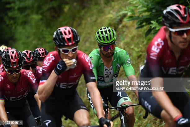 Slovakia's Peter Sagan wearing the best sprinter's green jersey rides with riders of Great Britain's Team Ineos cycling team during the sixth stage...