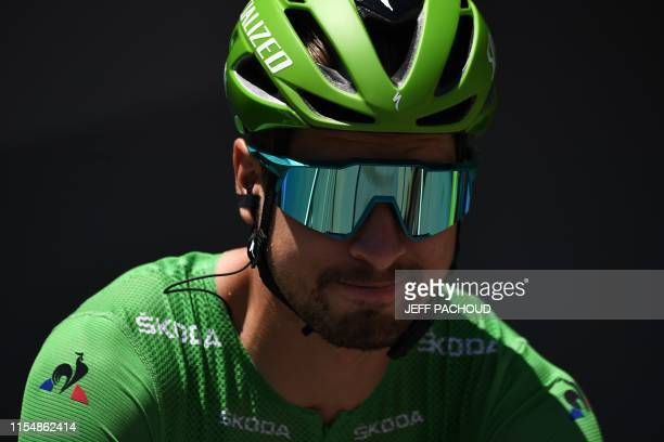 Slovakia's Peter Sagan, wearing the best sprinter's green jersey waits in the departing area during the signing in ceremony before the start of the...