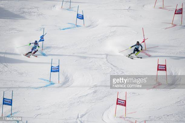Slovakia's Petra Vhlova clears the gate on her way to win during the final against Sweden's Anna SwenLarsson in the Women's parallel slalom race at...