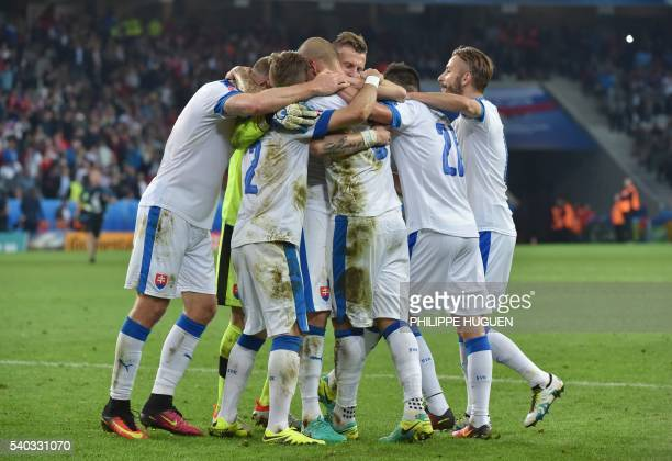 Slovakia's player celebrate during the Euro 2016 group B football match between Russia and Slovakia at the Pierre-Mauroy Stadium in...