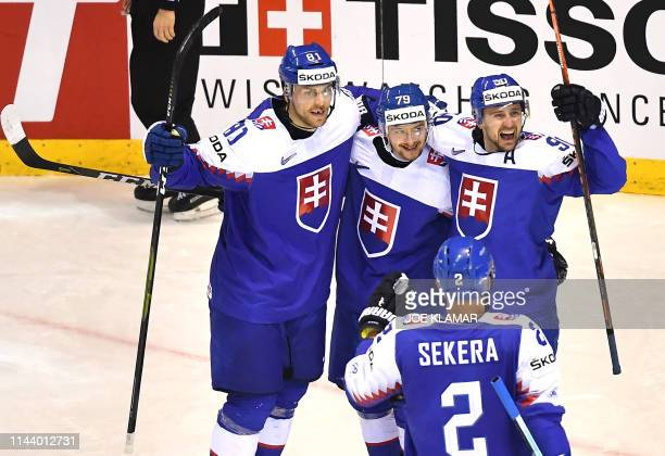Slovakia's players celebrate after scoring during the group A stage match Germany vs Slovakia of the 2019 IIHF Ice Hockey World Championship at Steel...