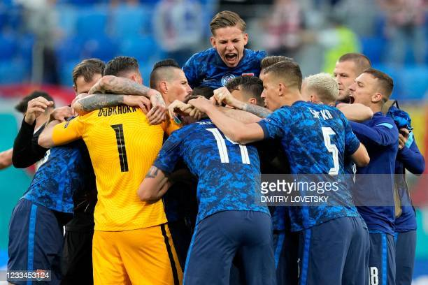 Slovakia's players celebrate after winning the UEFA EURO 2020 Group E football match between Poland and Slovakia at the Saint Petersburg Stadium in...