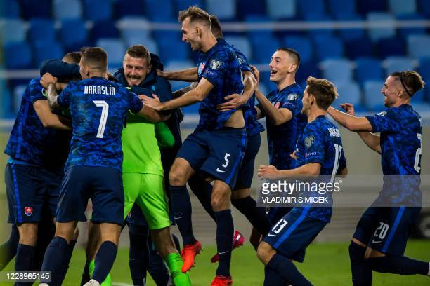 Slovakia's players celebrate their team's win after the Euro 2020 play-off semi-final football match between between Slovakia and Republic of Ireland...