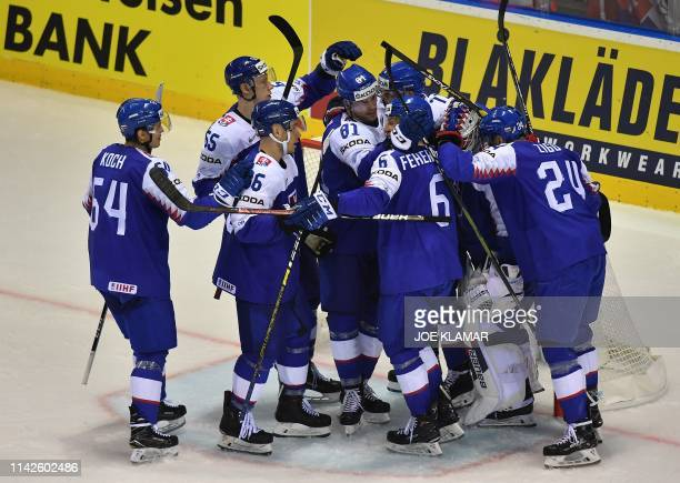 Slovakia's players celebrate their victory 4:1 during the IIHF Men's Ice Hockey World Championships Group A match between US and Slovakia on May 10,...