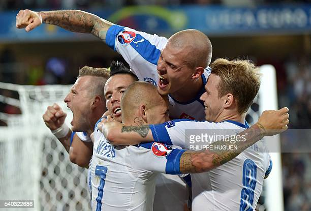 TOPSHOT Slovakia's players celebrates their second goal during the Euro 2016 group B football match between Russia and Slovakia at the PierreMauroy...