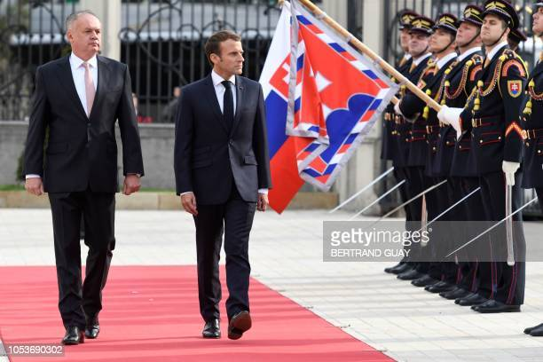 Slovakia's President Andrej Kiska and French President Emmanuel Macron review the honor guard during a welcoming ceremony at the Grassalkovitch...