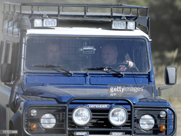 Slovakia's President Ivan Gasparovic drives during the Slovak multiple-function battalion from Hlohovec's military exercise in Zahorie, near the...