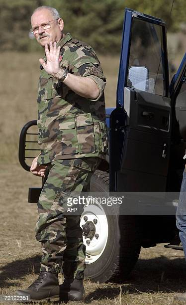 Slovakia's President Ivan Gasparovic waves at the press as he attends the Slovak multiple-function battalion from Hlohovec's military exercise in...