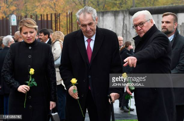 Slovakia's President Zuzana Caputova , Czech President Milos Zeman and German President Frank-Walter Steinmeier arrive to place flowers at the...