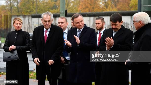 Slovakia's President Zuzana Caputova Czech President Milos Zeman Polish President Andrzej Duda and Hungarian President Janos Ader applaud German...