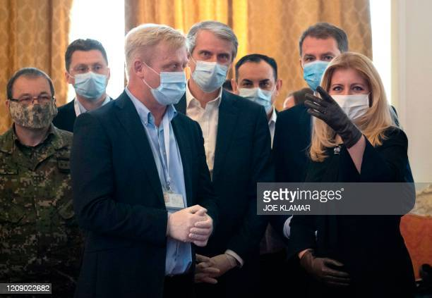 Slovakia's Prime Minister Igor Matovic and Slovakia's President Zuzana Caputova attend a meeting with members of the staff of the national...