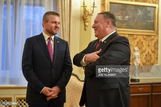 Slovakia's Prime Minister Peter Pellegrini and US Secretary of State Mike Pompeo talk on February 12 in Bratislava Slovakia during Pompeo's weeklong...