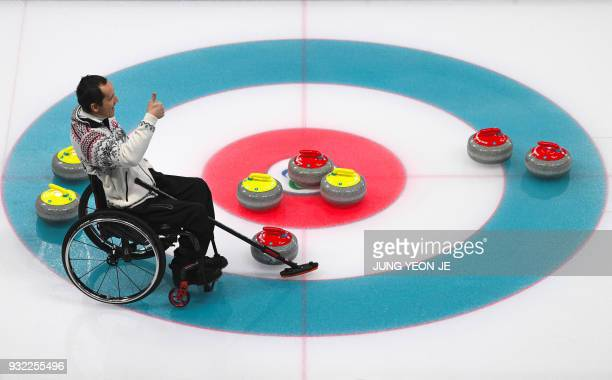 Slovakia's Radoslav Duris gestures during the wheelchair curling round robin session at the Gangneung Curling Centre during the Pyeongchang 2018...