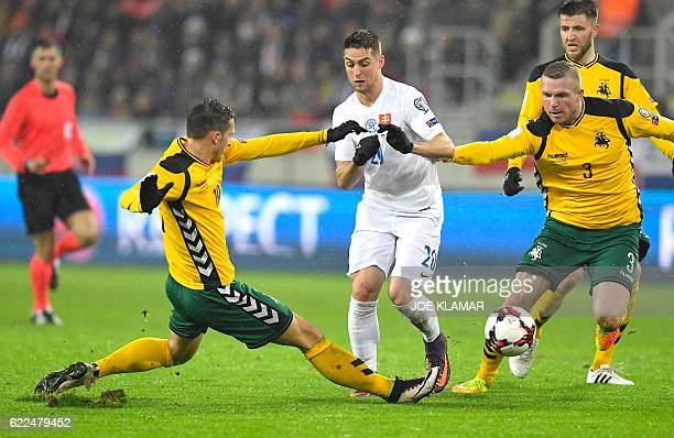 Slovakia's Robert Mak vies with Lithuania's Nerijus Valskis and Georgas Freidgeimas during the World Cup 2018 qualification football match between...