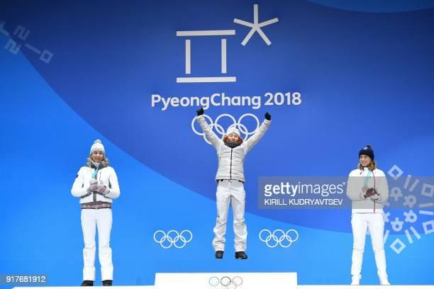 Slovakia's silver medallist Anastasiya Kuzmina, Germany's gold medallist Laura Dahlmeier and France's bronze medallist Anais Bescond pose on the...