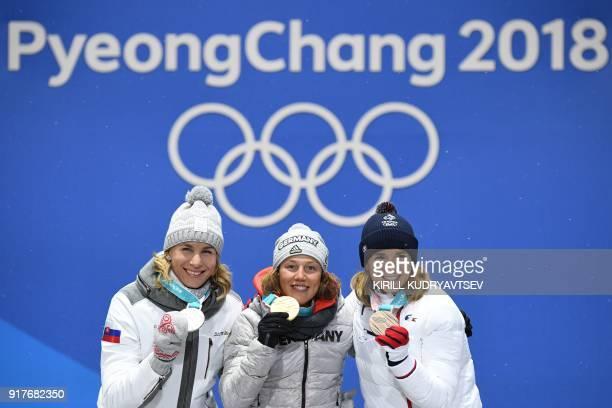 Slovakia's silver medallist Anastasiya Kuzmina Germany's gold medallist Laura Dahlmeier and France's bronze medallist Anais Bescond pose on the...